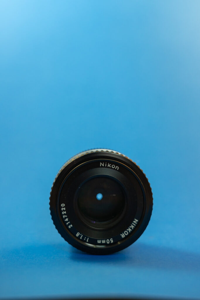 image of nikon lens in front of blue background
