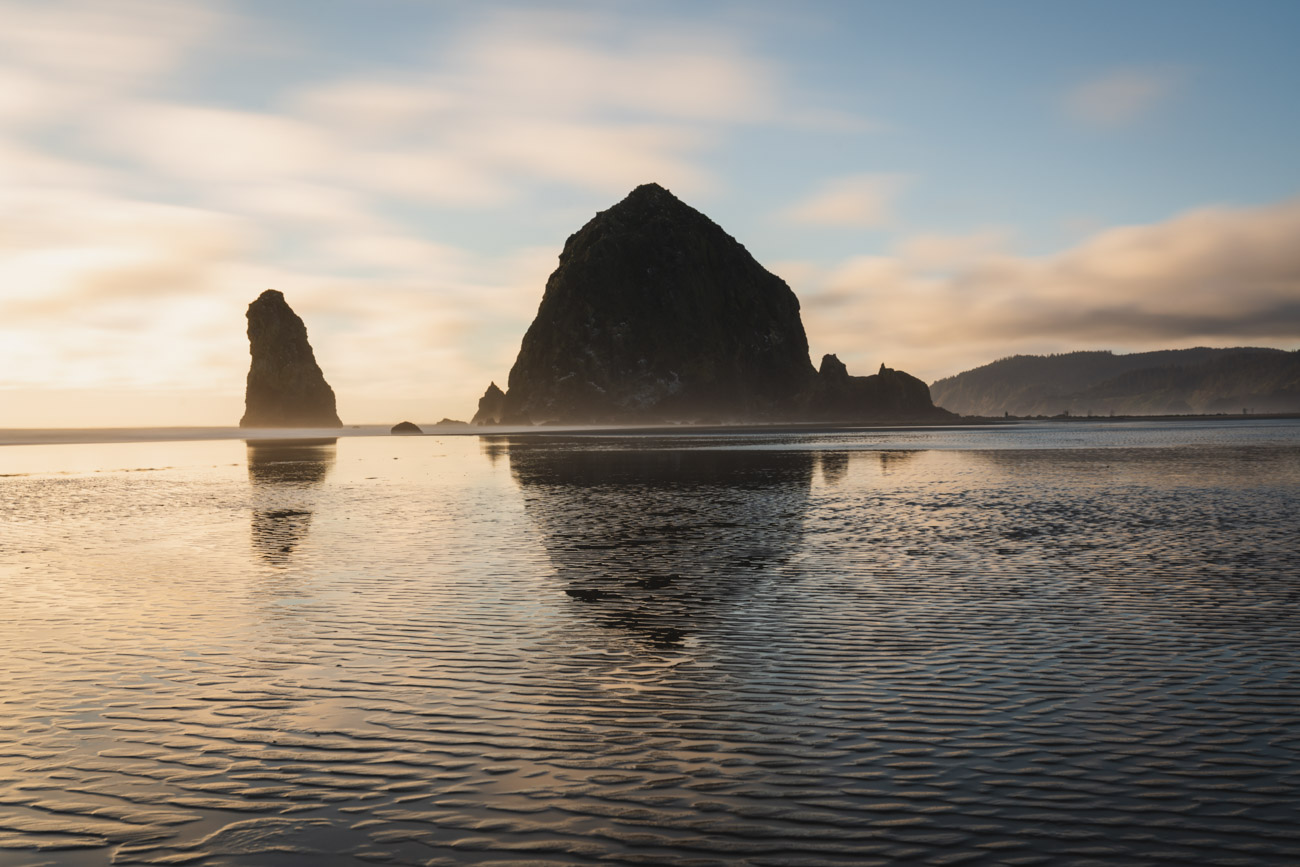 image of cannon beach haystack at sunset with clouds