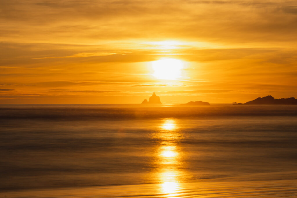 long exposure image of lighthouse in the sunset indian beach oregon