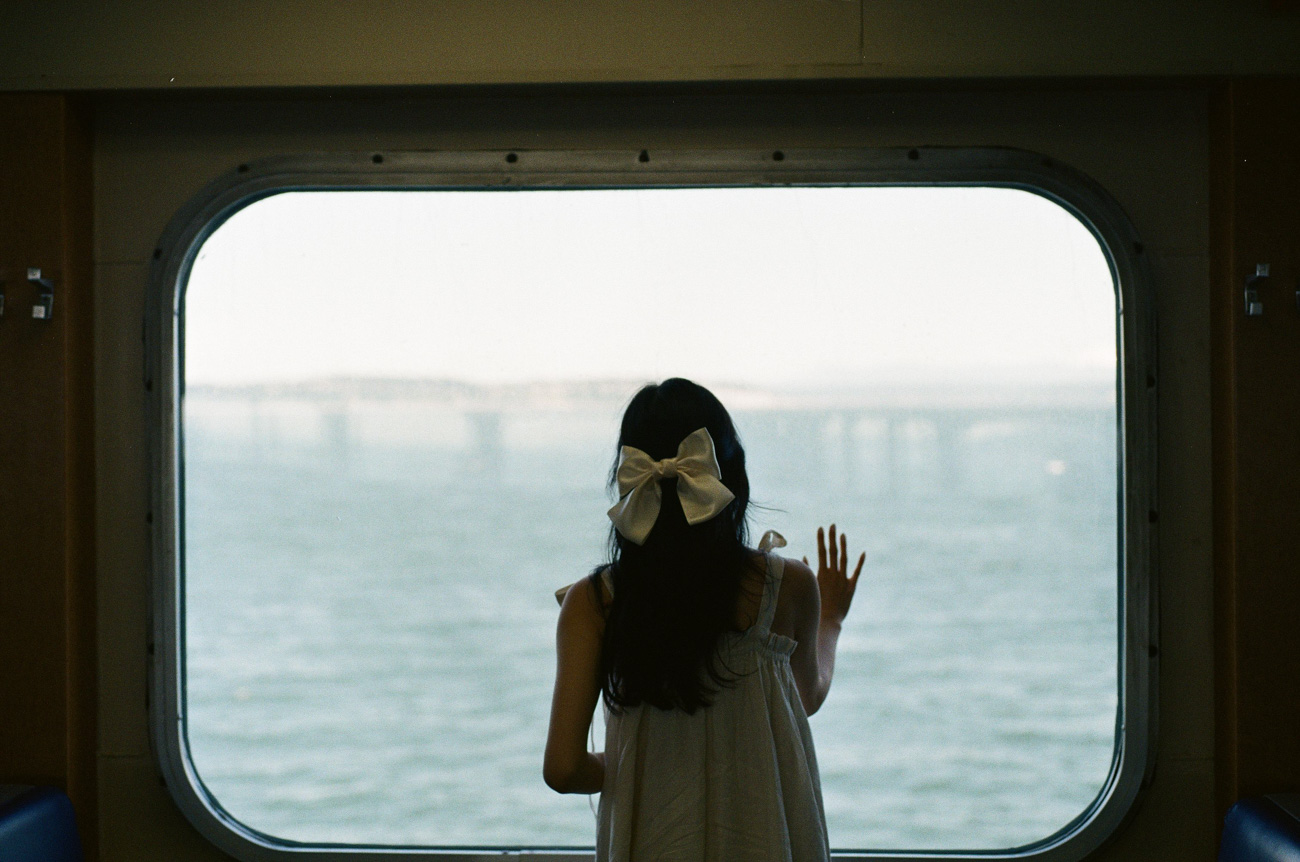 image of girl looking out of ferry window