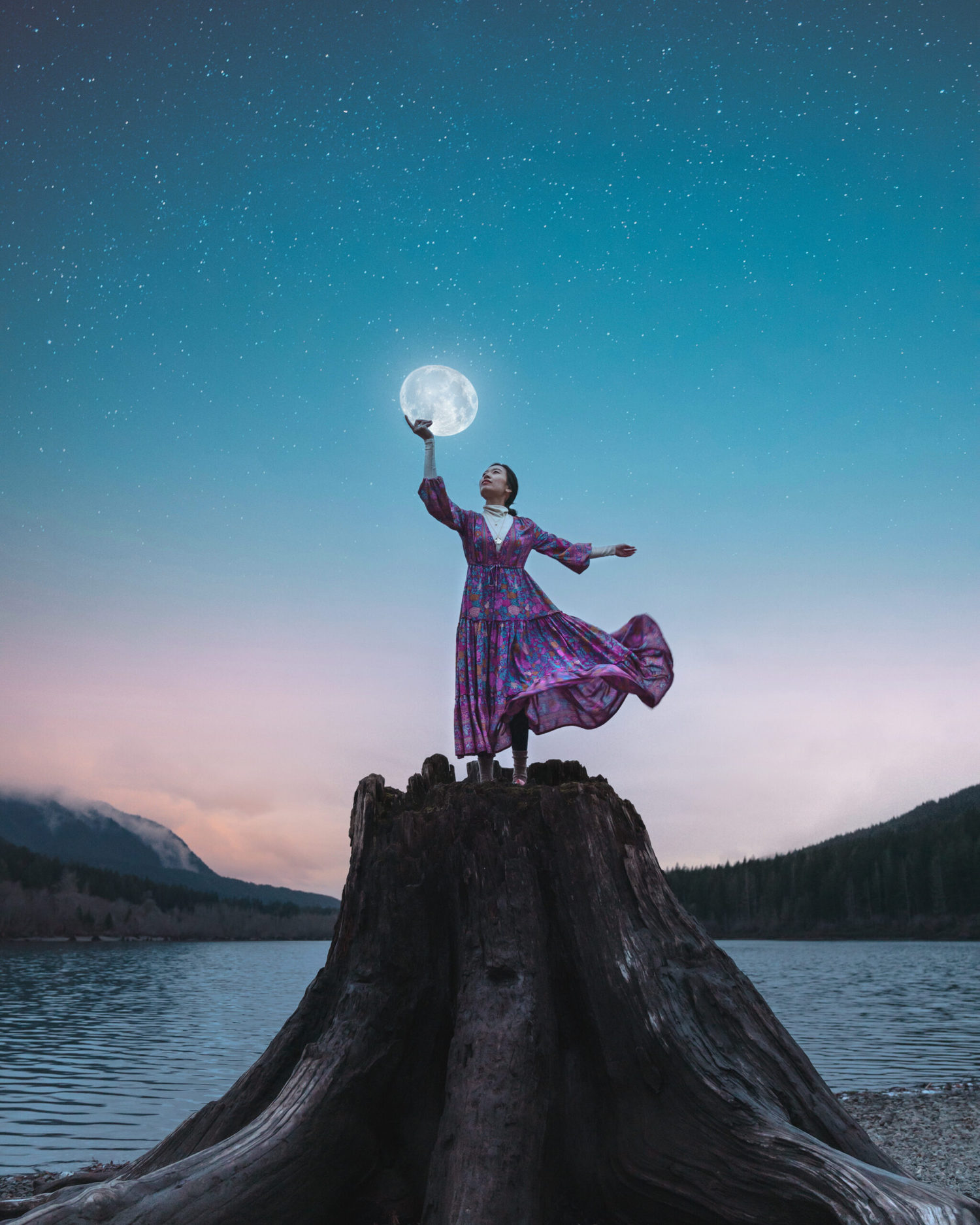 Photoshop edit of a girl holding up the moon